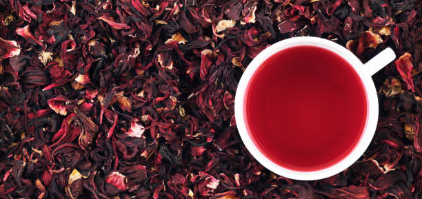 cup of hibiscus tea on the leaves, panorama - tea leaf stock photos and pictures