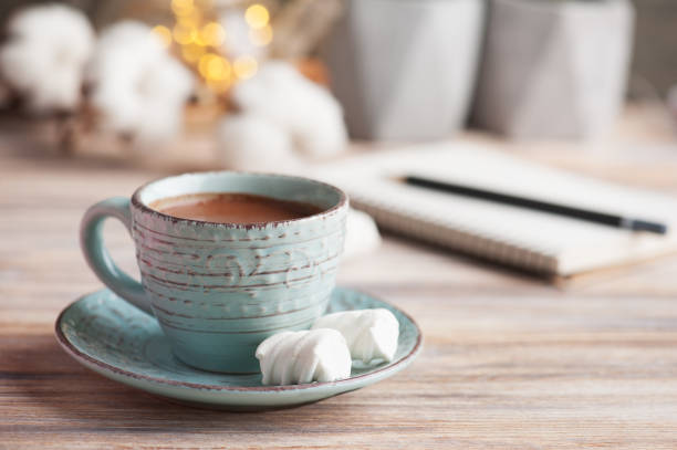 Cup of hot chocolate and lights stock photo