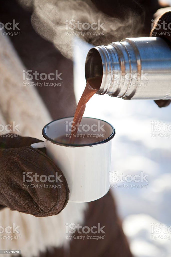 A cup of hot chocolate being poured stock photo