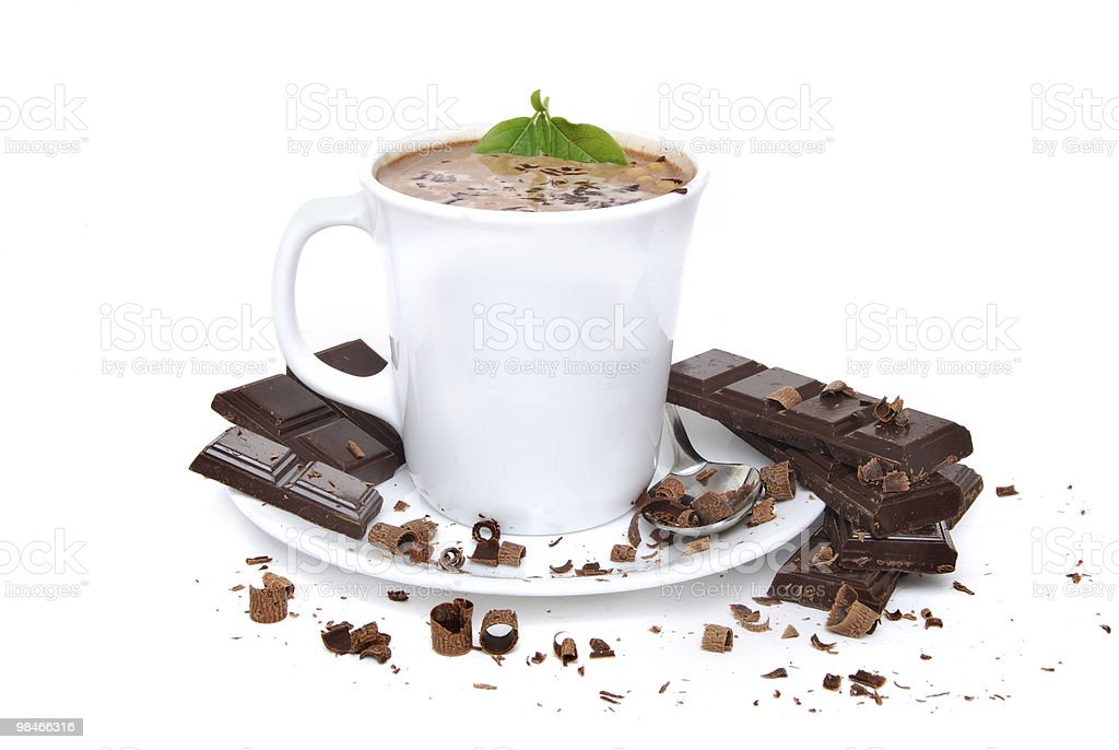 Cup of hot chocolate in mug surrounded by chocolates royalty-free stock photo