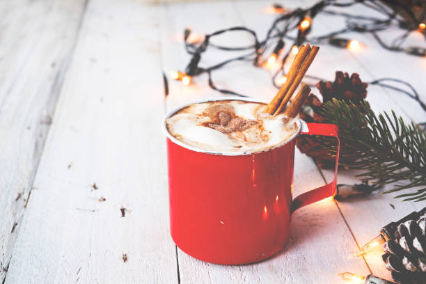 Cup of hot chocolate on wood table in Christmas Christmas background - Cup of hot chocolate on wood table with rustic decoration and Christmas lights. vintage color tone style. december stock pictures, royalty-free photos & images
