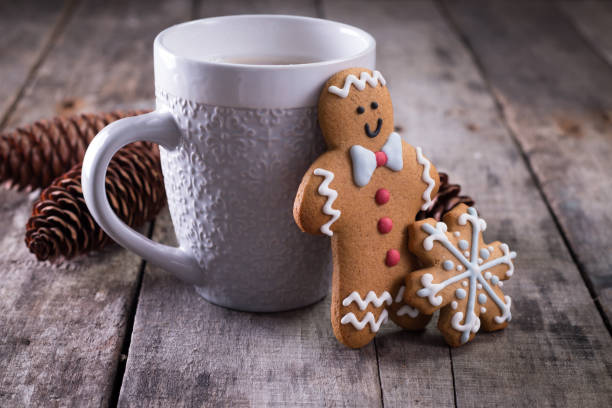 cup of hot chocolate or cocoa with gingerbread cookie christmas composition on vintage wooden table background. - christmas cookies stock pictures, royalty-free photos & images
