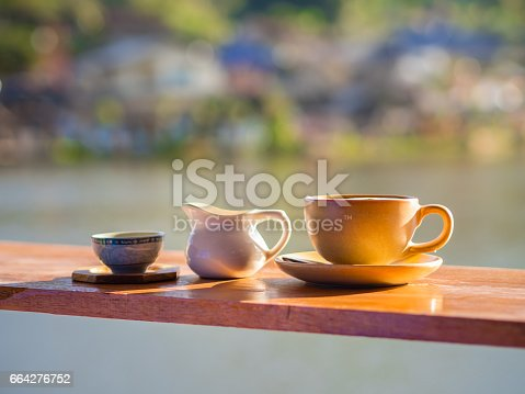 istock A cup of hot coffee on a brown wooden. 664276752