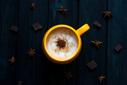 istock Cup of hot coffee on rustic wooden table, closeup photo warm sweater with mug, winter morning concept, t 663959230