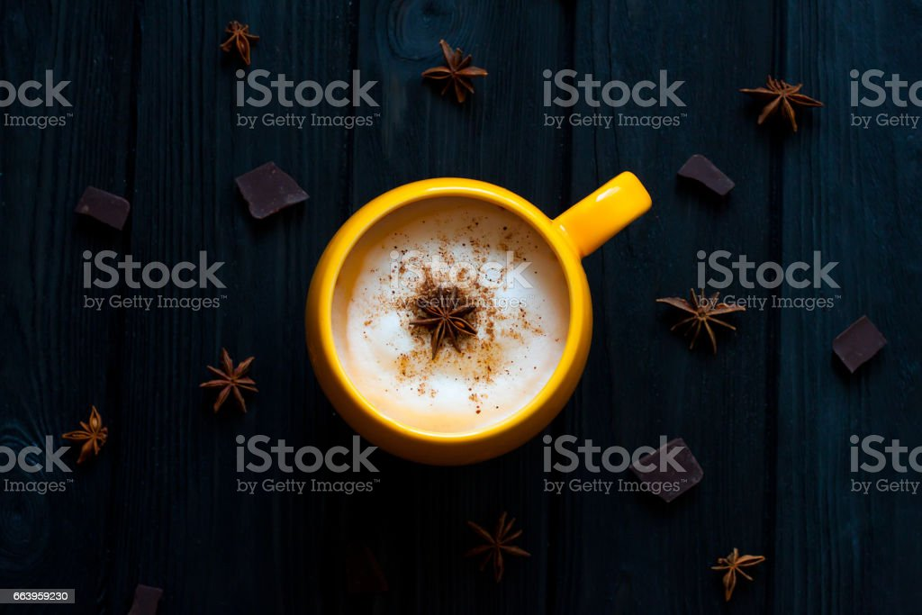 Cup of hot coffee on rustic wooden table, closeup photo warm sweater with mug, winter morning concept, t stock photo