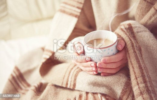 istock cup of hot coffee warming in the hands of girl 532851443