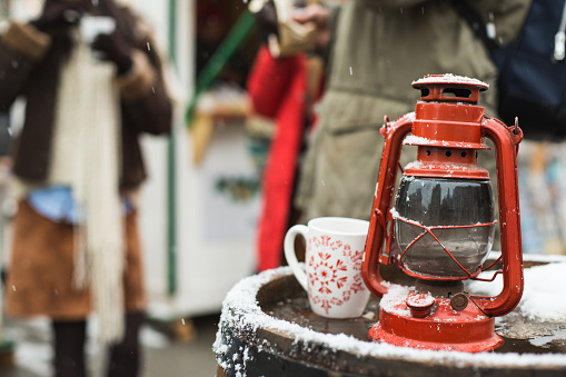 Cup of hot drink on wooden barrel