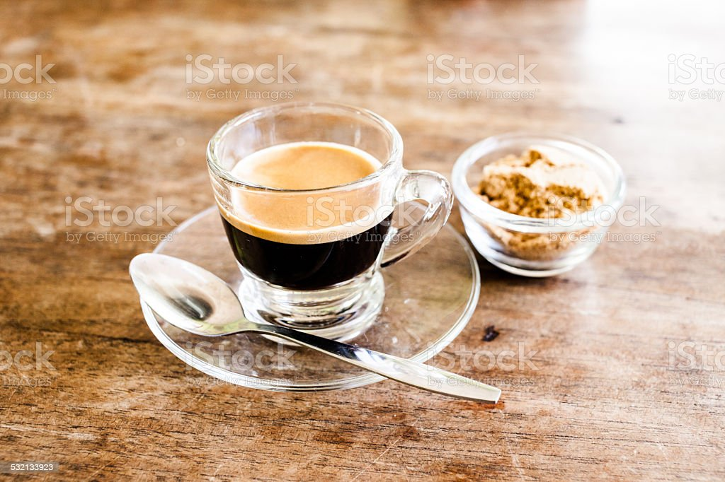 Cup of hot espresso coffee on wooden table. stock photo