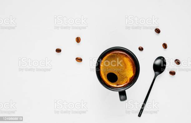 Cup of hot espresso with foam located on a wide white background with picture id1249868819?b=1&k=6&m=1249868819&s=612x612&h=qwxcx36todfzzmmfxanqhkz1sgvqruqytl9b7giyvtw=