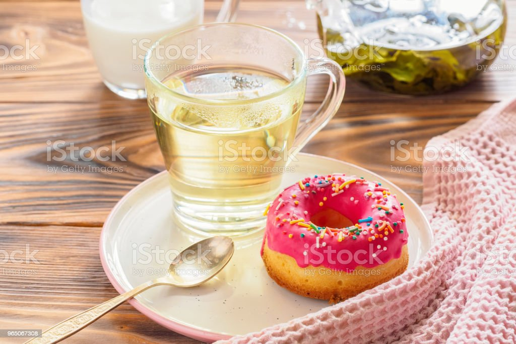 Cup of hot green tea beverages with donut glazed royalty-free stock photo