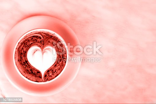 istock Cup of hot latte coffee on marble table background with love art. 1078505838