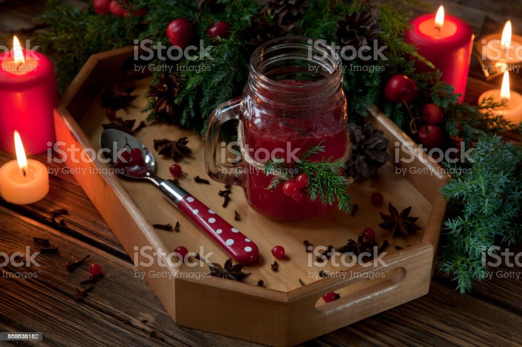 Cup of hot spicy tea on a tray with branches of coniferous tree. Autumn and winter, Christmas concept stock photo