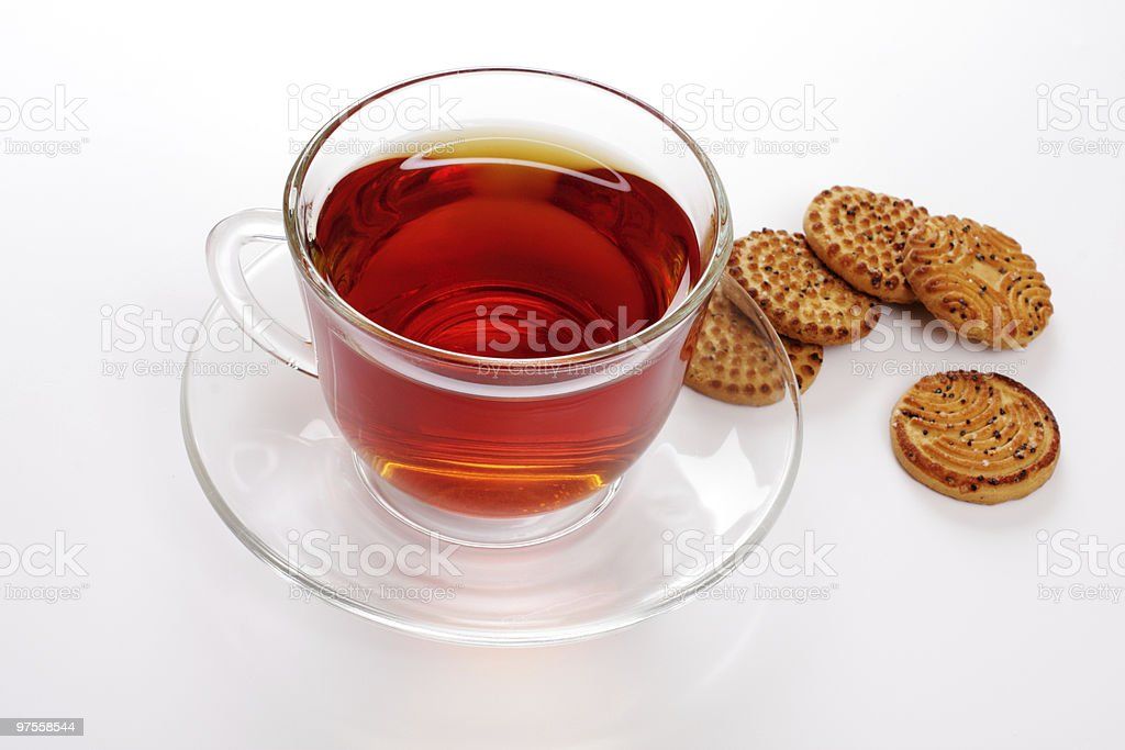 Cup of hot tea and cookies, over white royalty-free stock photo