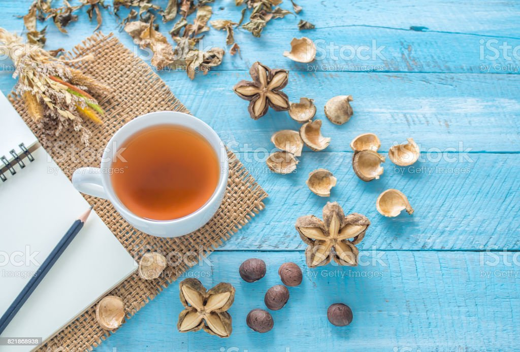 A cup of hot tea of sacha inchi on wooden table. stock photo