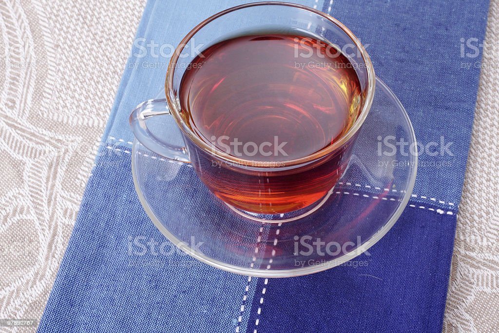 Cup of hot tea on a dark blue napkin royalty-free stock photo