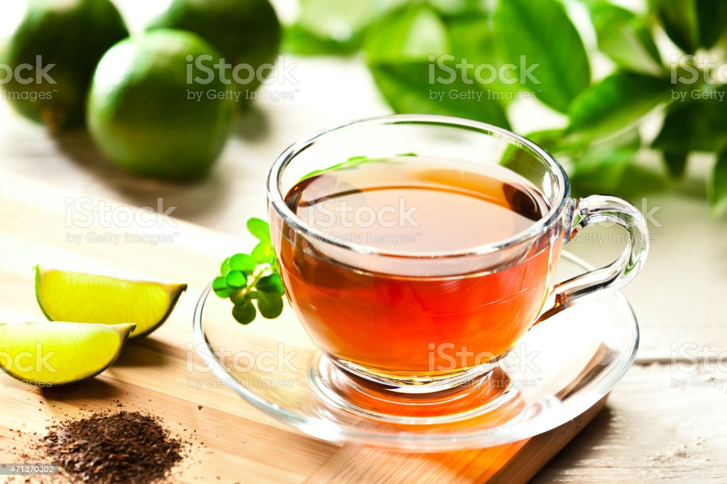 Cup of hot tea on wood table stock photo