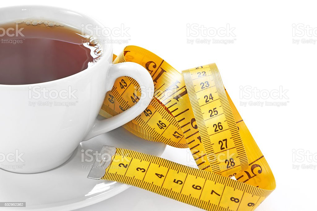 Cup of hot tea with tape measure stock photo