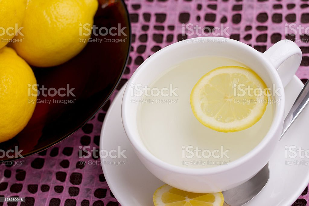 Cup Of Hot Water And Lemon Slice Stock Photo