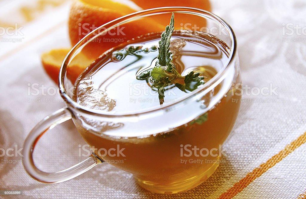 Cup of ice orange-mint tea royalty-free stock photo