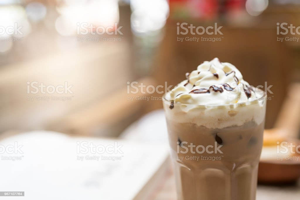 cup of iced mocha coffee on wooden table background. food and drink concept stock photo