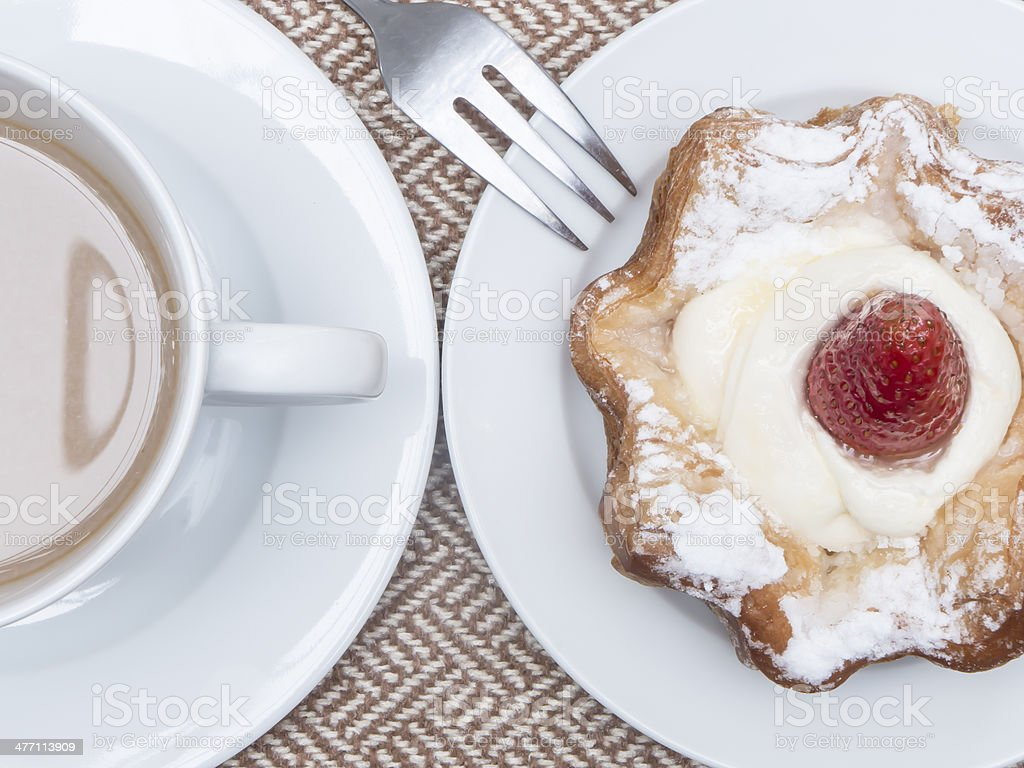 Cup of latte coffee with cake royalty-free stock photo