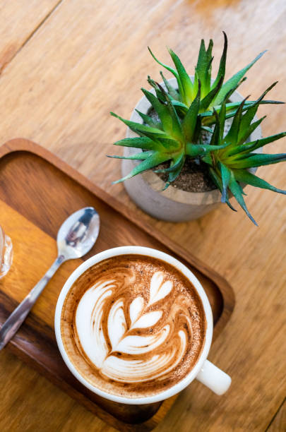 A cup of latte on wooden table stock photo