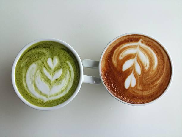 cup of matcha and latte art coffee so delicious - grüner tee koffein stock-fotos und bilder