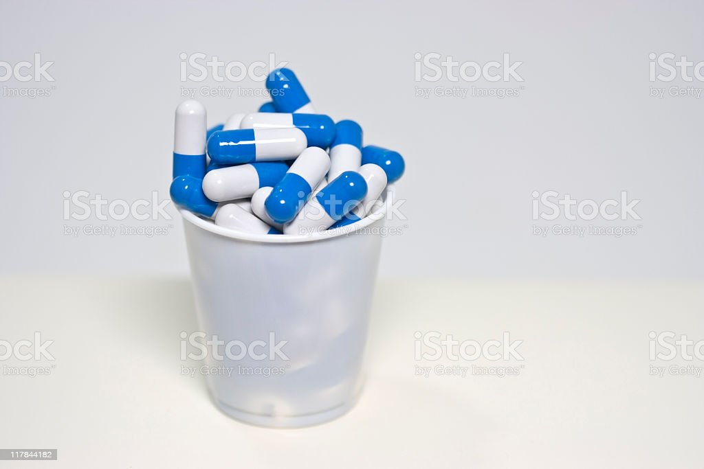 Cup of Meds stock photo