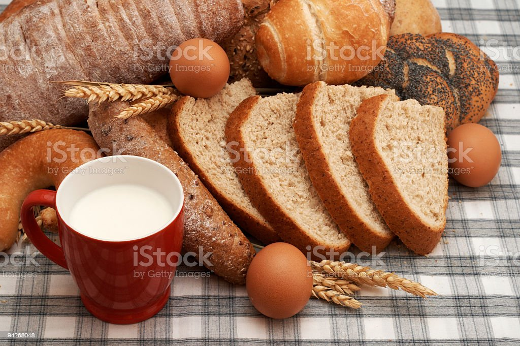 Cup of milk, eggs and various baking stock photo