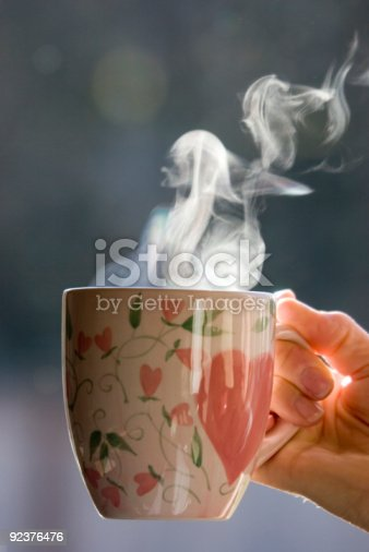 A steaming hot cup of coffee