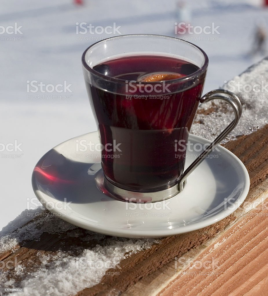 Cup of mulled wine, snow on the background royalty-free stock photo