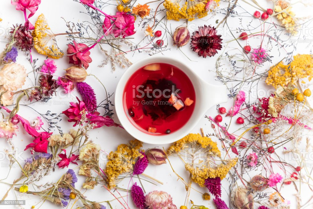Cup of organic fruit tea and herbs stock photo