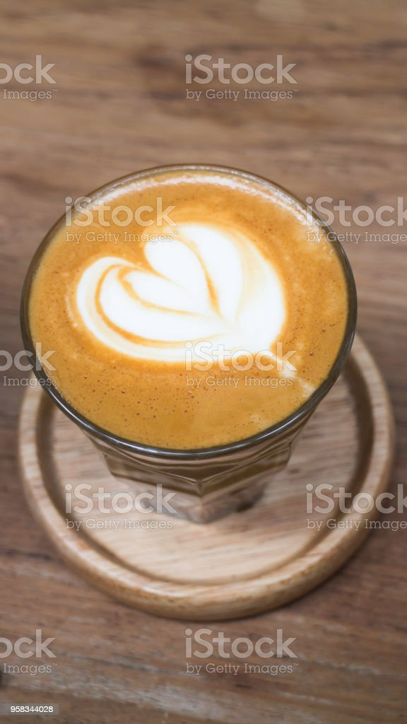Cup of piccolo latte coffee with latte art stock photo