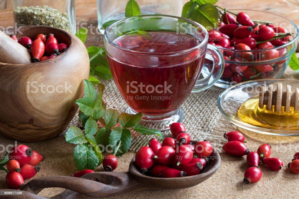 A cup of rose hip tea stock photo