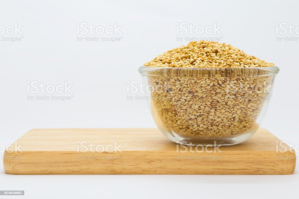 Cup of sesame seed on wooden borad stock photo
