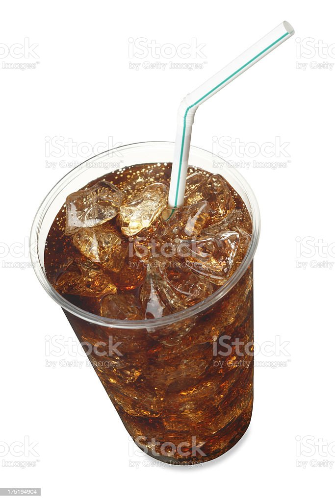 Cup of soda served with ice and a straw royalty-free stock photo