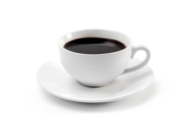 cup of strong black coffee in a white cup and saucer - coffee stock pictures, royalty-free photos & images