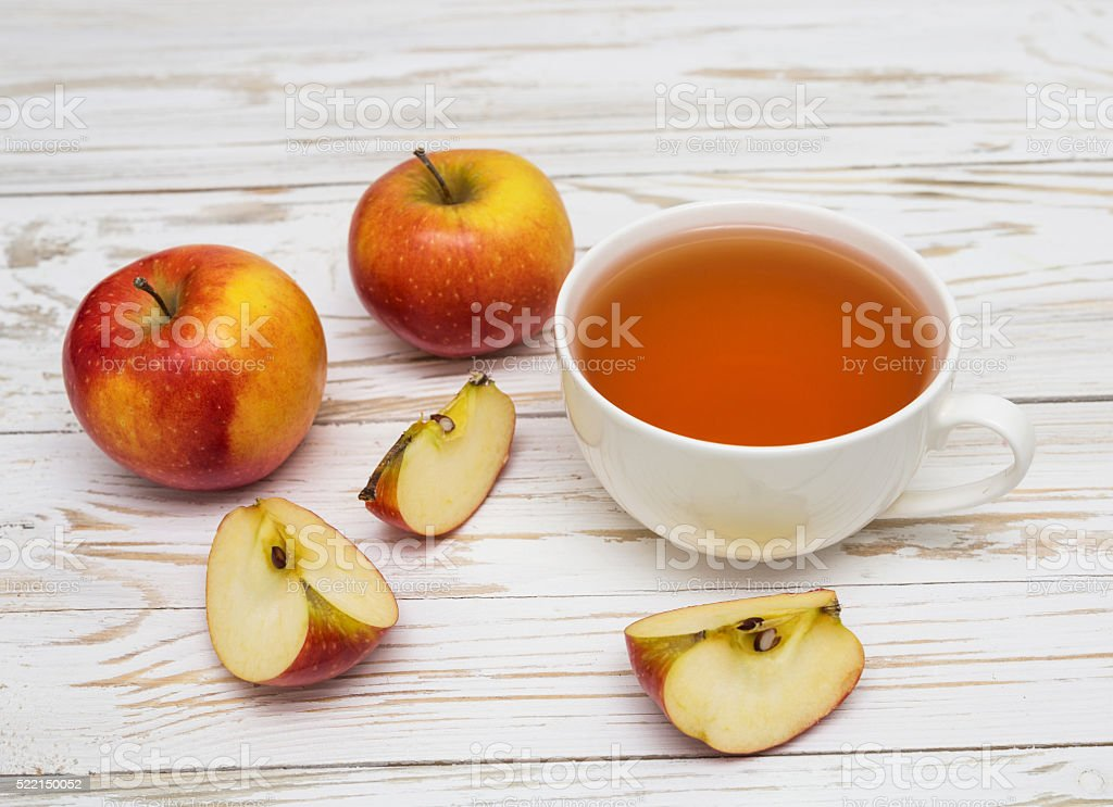 Cup of tea and apples stock photo