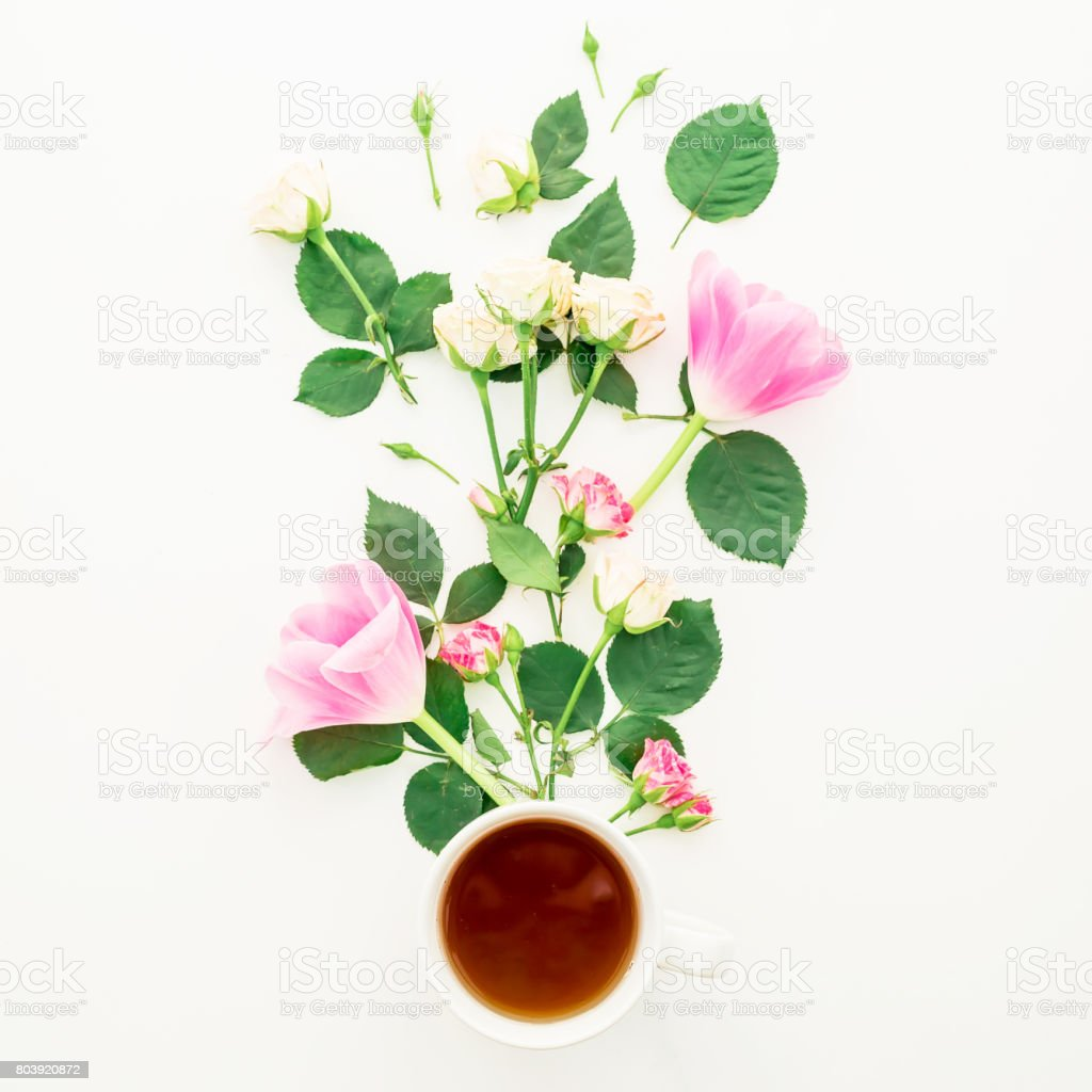 Cup Of Tea And Flowers With Leaves On White Background Flat Lay Top