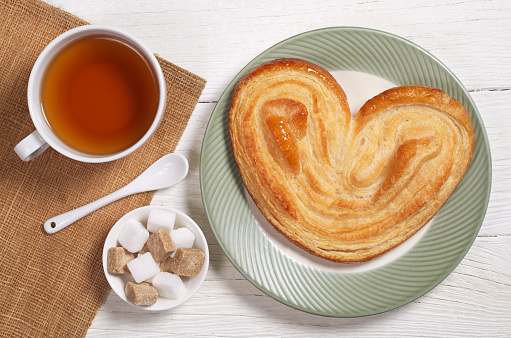 Cup of tea and french palmier cookie