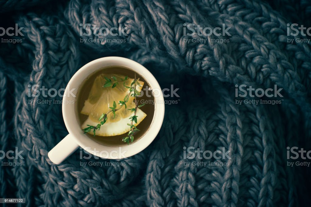 Cup of tea  and gray scarf stock photo