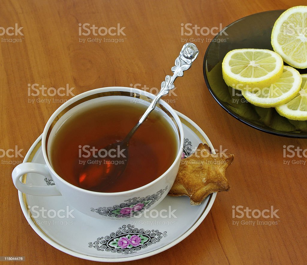 Cup of tea and lemon royalty-free stock photo