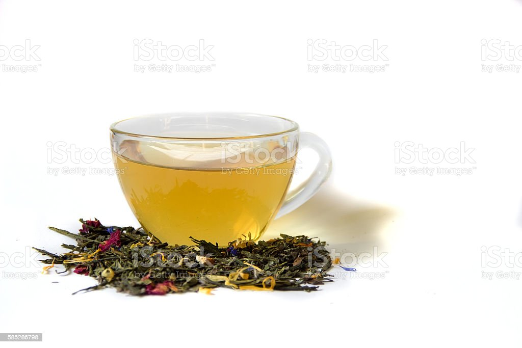 Cup of tea and loose tea on a white background. stock photo