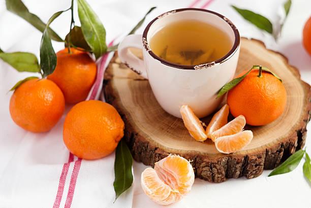 Cup of tea and mandarins stock photo