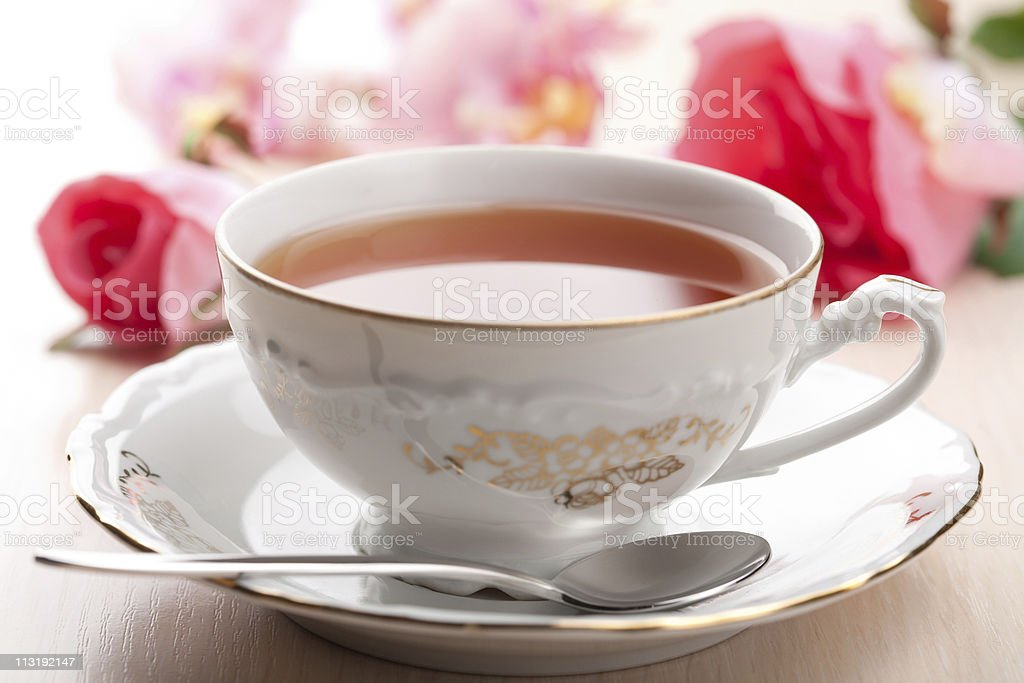 cup of tea and roses stock photo