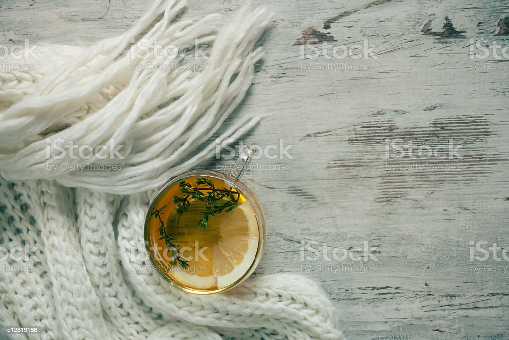 Cup of tea  and white scarf stock photo