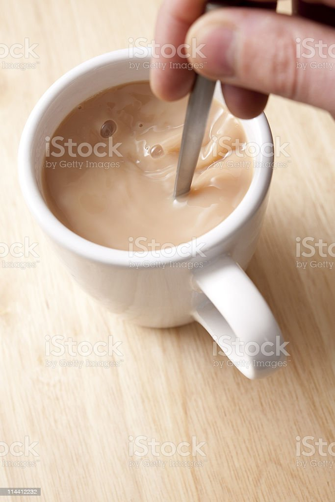 cup of tea being stirred royalty-free stock photo