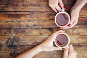 istock A cup of tea in the hands. Selective focus. Drink. 1056740214