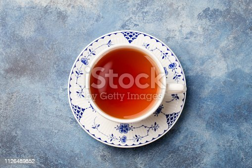 Cup of tea on a blue stone background. Copy space. Top view