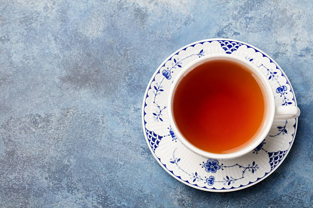 Cup of tea on a blue stone background. Top view stock photo